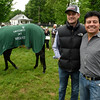 2016 Kentucky Derby winner Nyquist grabs a little snack of grass as while Team O'Neil members Jack Sisterson, left and Leandro Mora pose for a picture the day after the Derby in the barn area of Churchill Downs May 8, 2016 in Louisville, KY Photo by Skip Dickstein