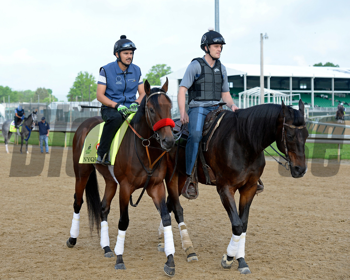 Nyquist with Jonny Garcia jogging with Jack Sisterson on Satire.<br /> Works at Churchill Downs on May 2, 2016, in Louisville, Ky.