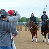 Land Over Sea with Jonny Garcia and Jack Sisterson on Satire going by the barn area crowd.<br /> Works at Churchill Downs on May 4, 2016, in Louisville, Ky.
