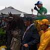 Exaggerator with jockey Kent Desormeaux is lead to the winner's circle by part owner Matt Bryan after winning the 141st runnoing of the Preakness Stakes.  Photo by Skip Dickstein