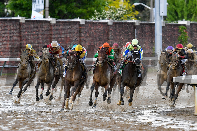 Always Dreaming, John Velazquez aborad, leads the field around the final turn in the 143rd running of the Kentucky Derby.