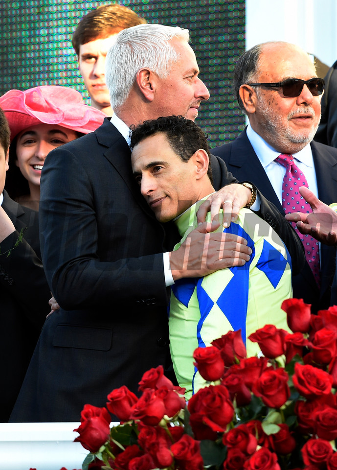 Jockey John Velazquez gets a hug from trainer Todd Fletcher after winning the 143rd running of the Kentucky Derby May 6, 2017 in Louisville, Kentucky.  Photo by Skip Dickstein