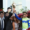 Jockey John Velazquez holds the winner's trophy aloft and is joined by his family after winning the 143rd running of the Kentucky Derby on Always Dreaming May 6, 2017 in Louisville, Kentucky.  Photo by Skip Dickstein