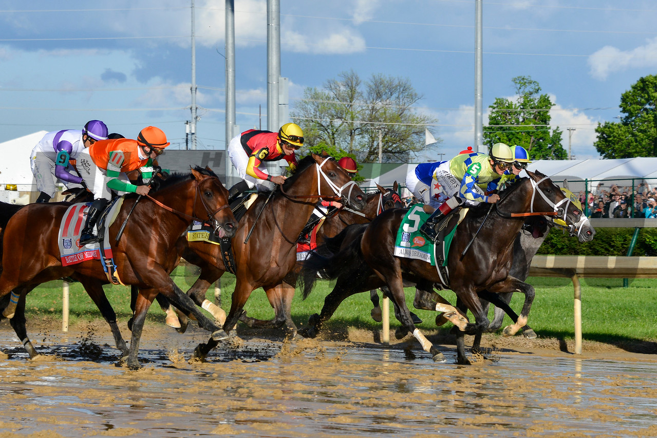 Always Dreaming, John Velazquez aboard, leads the field from the gate on the start of the 143rd running of the Kentucky Derby.