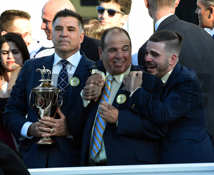 Owners Vince Viola, left Anthony Bonomo Sr and Anthony Bonomo Jr. celebrate after winning the 143rd running of the Kentucky Derby May 6, 2017 in Louisville, Kentucky.  Photo by Skip Dickstein