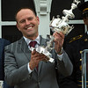 Cloud Computing's trainer holds the winner's trophy aloft after winning the 142nd running of the Preakness Stakes Saturday May 20, 2017 at Pimlico Race Course in Baltimore, MD.  Photo by Skip Dickstein
