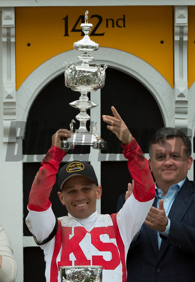 Cloud Computing's jockey holds the winner's trophy aloft after winning the 142nd running of the Preakness Stakes Saturday May 20, 2017 at Pimlico Race Course in Baltimore, MD.  Photo by Skip Dickstein