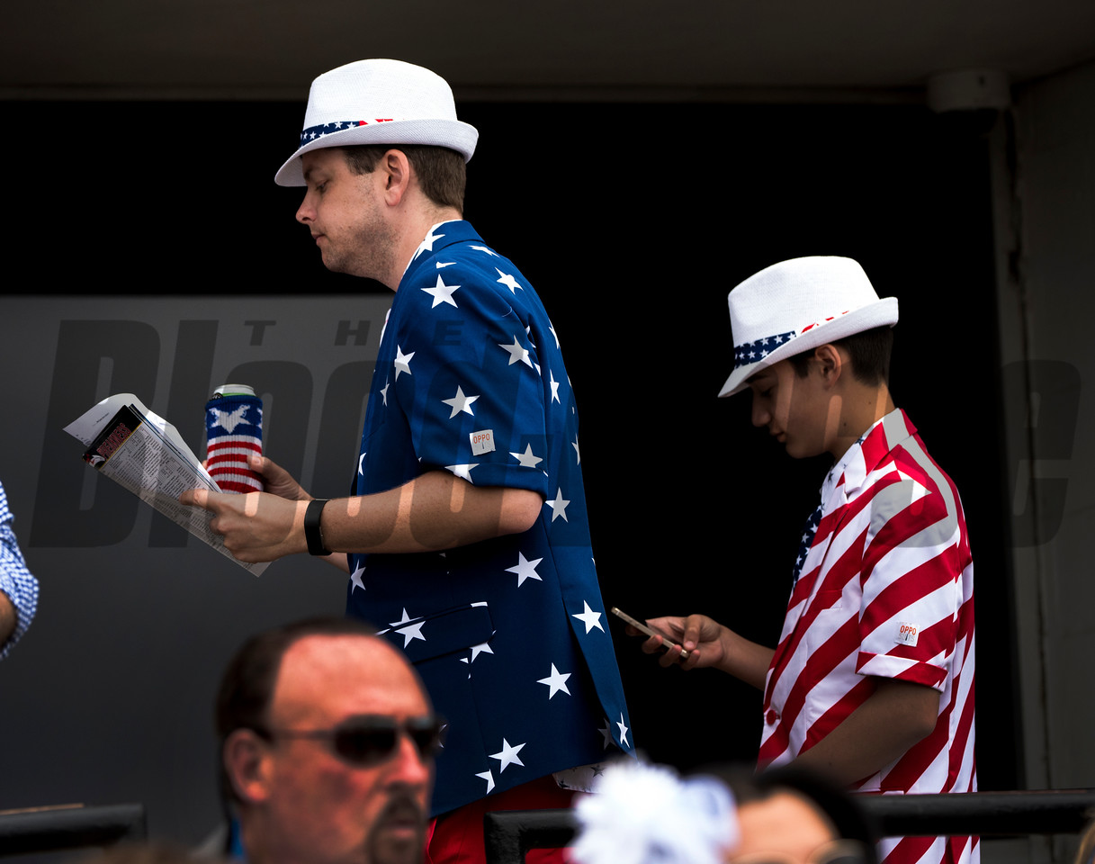 Two race patrons show their colors before the 142nd running of the Preakness Stakes at May 20, 2017 at Pimlico Race Course in Baltimore, MD. Photo by Skip Dickstein