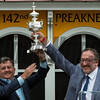Cloud Computing's co-owners Bill Lawrence, left and Seth Klarman hold the winner's trophy aloft after winning the 142nd running of the Preakness Stakes Saturday May 20, 2017 at Pimlico Race Course in Baltimore, MD.  Photo by Skip Dickstein