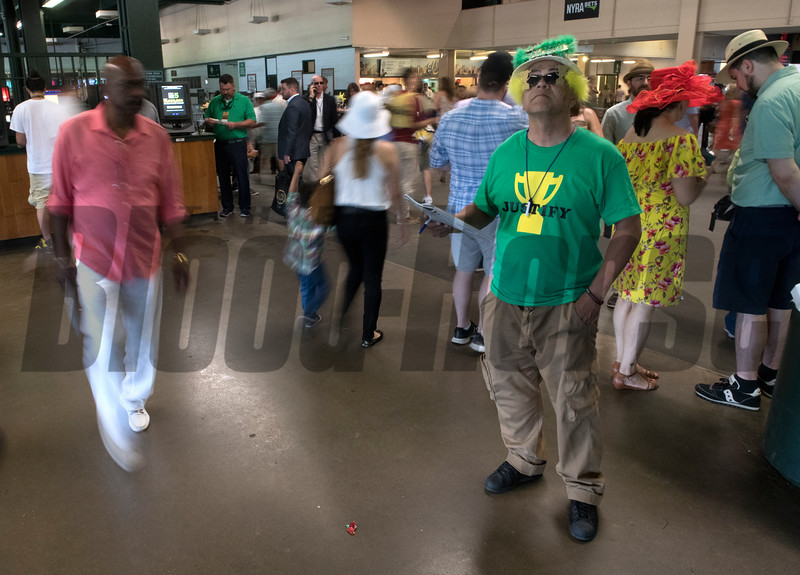 Justify fan checks his plays a Belmont Park on Belmont Stakes Day 150 in Elmont, N.Y.  Photo by Skip Dickstein