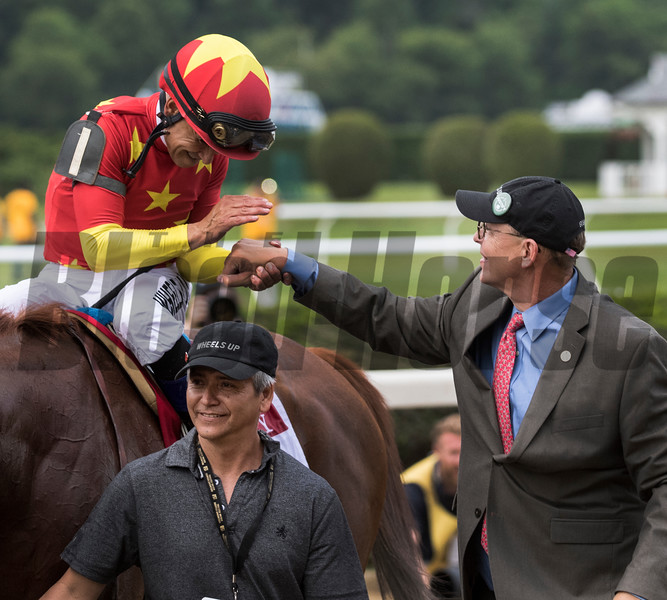Jockey Mike Smith congratulates Elliott walden after winning the 150th running of the Belmont Stakes.  Photo by Skip Dickstein