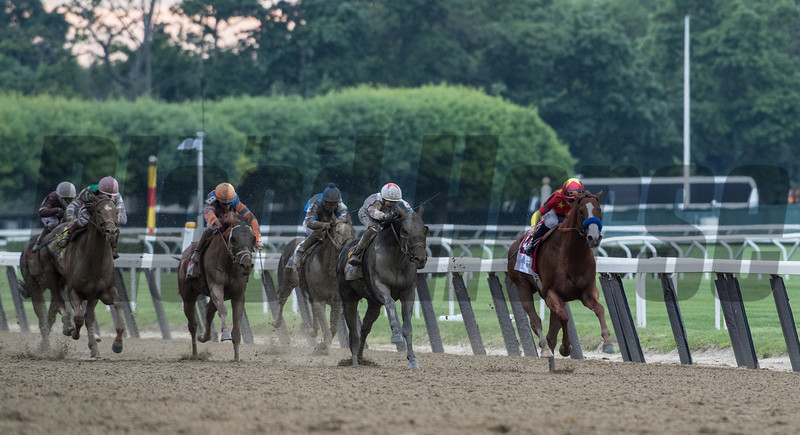 Justify with Jockey Mike Smith holds off the field to win the 150th running of the Belmont Stakes.  Photo by Skip Dickstein