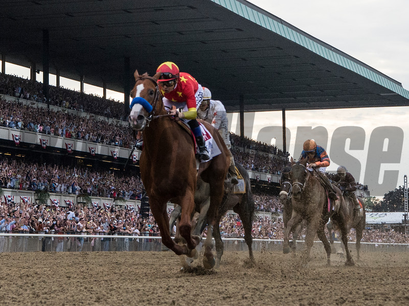 Justify with jockey Mike Smith wins the 150th running of the Belmont Stakes and the coveted Triple Crown of Thoroughbred race at Belmont Park Saturday June 9, 2018, in Elmont, N.Y.  (Skip Dickstein/