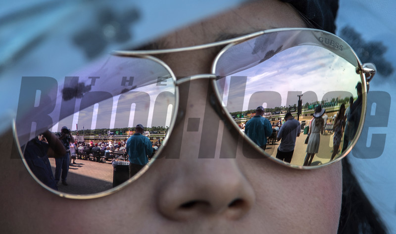 Hats and fans reflected in glasses at Belmont Park on Belmont Stakes Day 150 in Elmont, N.Y.  Photo by Skip Dickstein