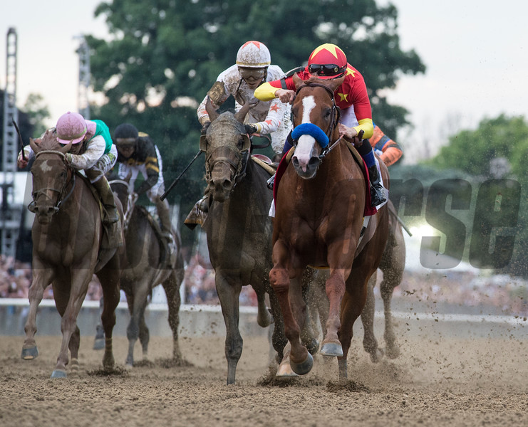 Justify with jockey Mike Smith wins the 150th running of the Belmont Stakes and the coveted Triple Crown of Thoroughbred race at Belmont Park Saturday June 9, 2018, in Elmont, N.Y.  (Skip Dickstein