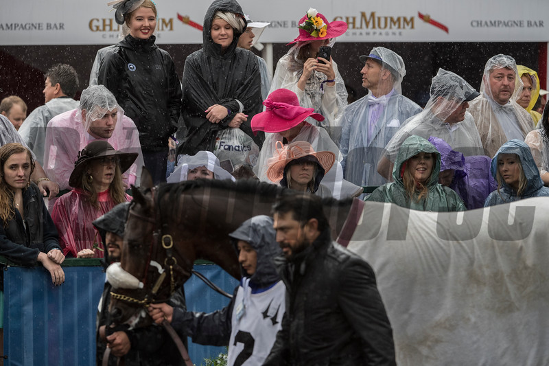 The nice hats are now dripping with water due to heavy rain at Churchill Downs on Kentucky Derby Day 144 Saturday May 5, 2018 in Louisville, Kentucky.  Photo by Skip Dickstein