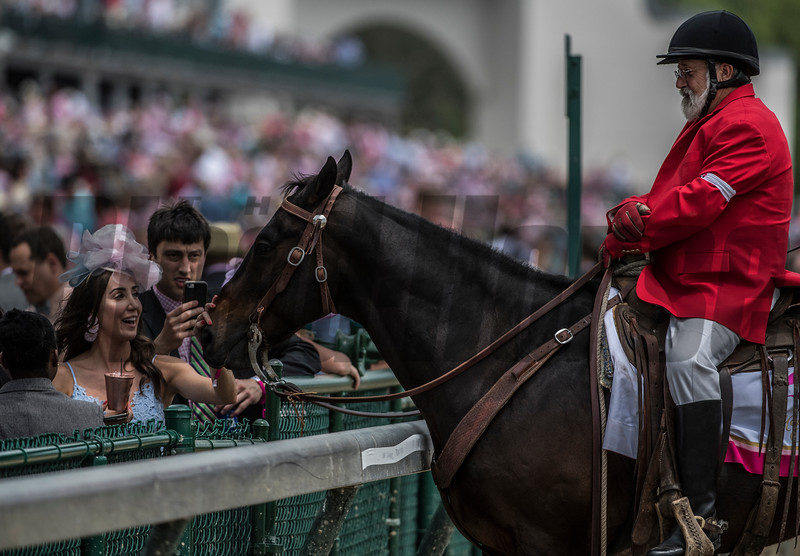 Outrider Kenny Lavergne's horse has all the fun on Oaks Day at Churchill Downs Friday May 4, 2018 in Louisville, Kentucky.  Photo by Skip Dickstein