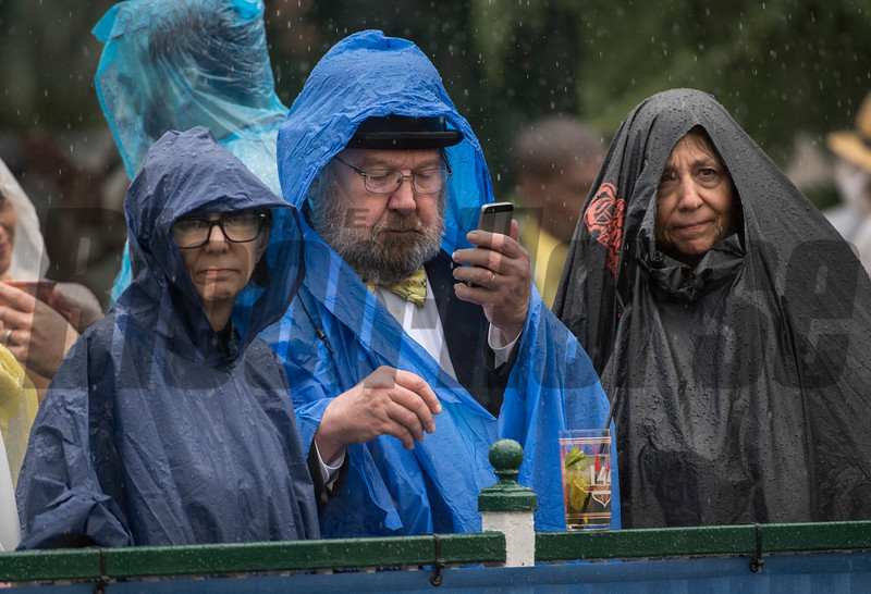 Race fans are a little uncomfortable due to heavy rain at Churchill Downs on Kentucky Derby Day 144 Saturday May 5, 2018 in Louisville, Kentucky.  Photo by Skip Dickstein