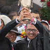 Owners Ah Khing Teo and Kenny Troutt hold up the winners's trophy after Justify wins the 144th running of the Kentucky Derby May 5, 2018 at Churchill Downs in Louisville, Kentucky Photo by Skip Dickstein