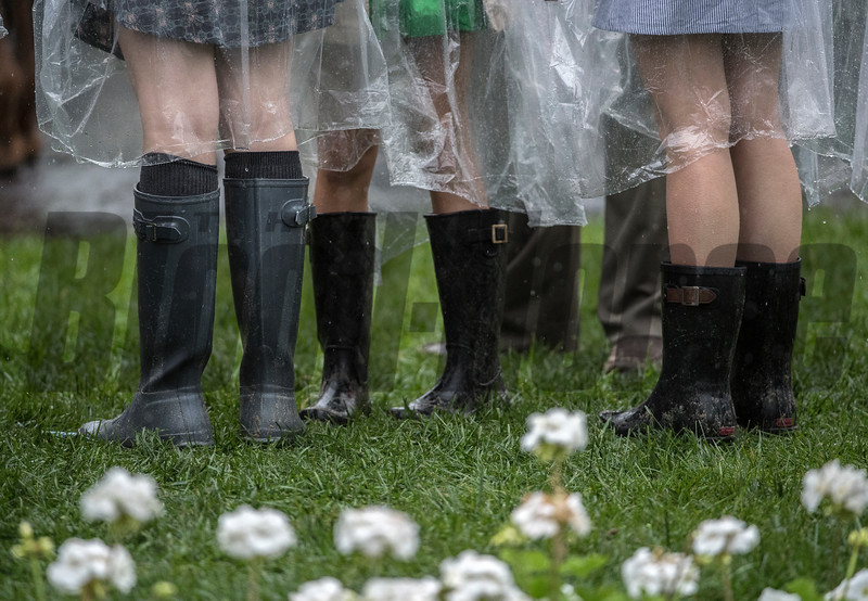 The fashions of the day are taking a decided utilitarian look due to heavy rain at Churchill Downs on Kentucky Derby Day 144 Saturday May 5, 2018 in Louisville, Kentucky.  Photo by Skip Dickstein