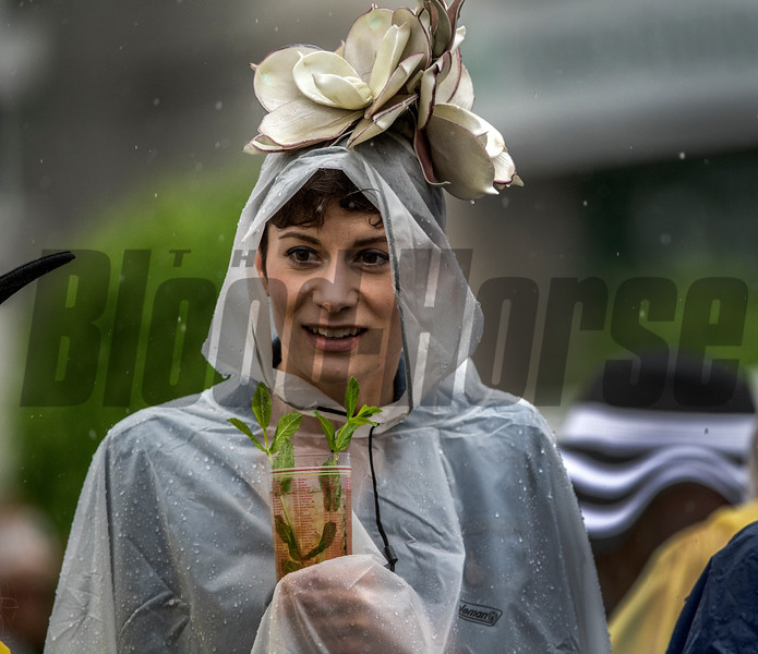 A hard core racing fan enjoys a mint julep and dealing with the heavy rain at Churchill Downs on Kentucky Derby Day 144 Saturday May 5, 2018 in Louisville, Kentucky.  Photo by Skip Dickstein