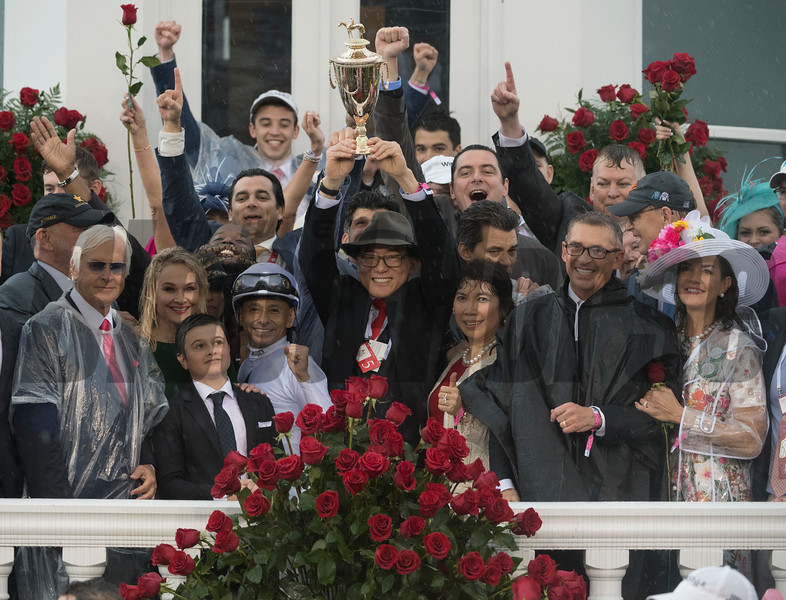 Trainer Bob Baffert stands by his son Bode as he hoists the winner's trophy aloft after Justify won the 144th running of the Kentucky Derby May 5, 2018 at Churchill Downs in Louisville, Kentucky  Photo: Skip Dickstein