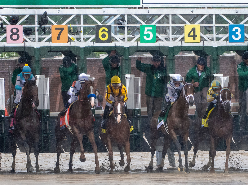 Justify, with Mike Smith aboard (white cap), wins the 144th running of the Kentucky Derby at Churchill Downs.