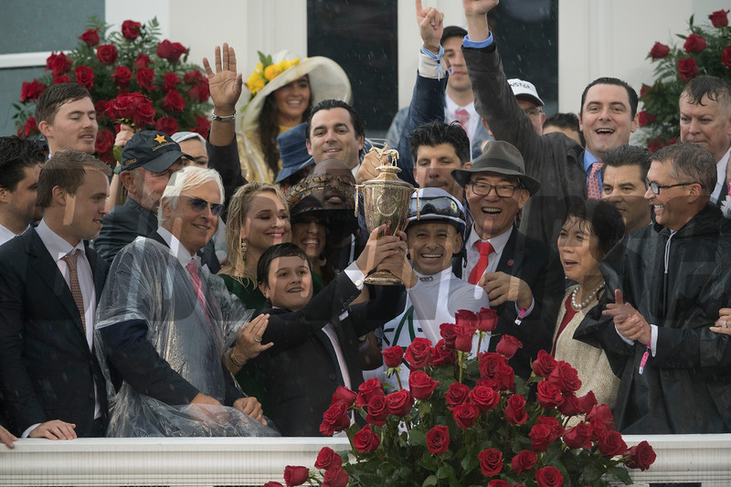 Trainer Bob Baffert stands by his son Bode as he hoists the winner's trophy aloft after Justify won the 144th running of the Kentucky Derby May 5, 2018 at Churchill Downs in Louisville, Kentucky Photo by Skip Dickstein
