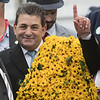 Assistant to Bob Baffert Jimmy Barnes holds up the one more sign after Justify wins the 143rd running of the Preakness Stakes. Photo by Skip Dickstein