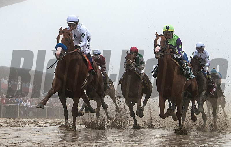 Justify jumps something as he passes the clubhouse for the first time in Preakness 143.  Photo by Skip Dickstein