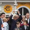 Trainer Bob Baffert holds the winner's trophy aloft after Justify wins the 143rd running of the Preakness Stakes. Photo by Skip Dickstein