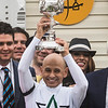 Jockey Mike Smith holds the winner's trophy aloft after wins the 143rd running of the Preakness Stakes. Photo by Skip Dickstein