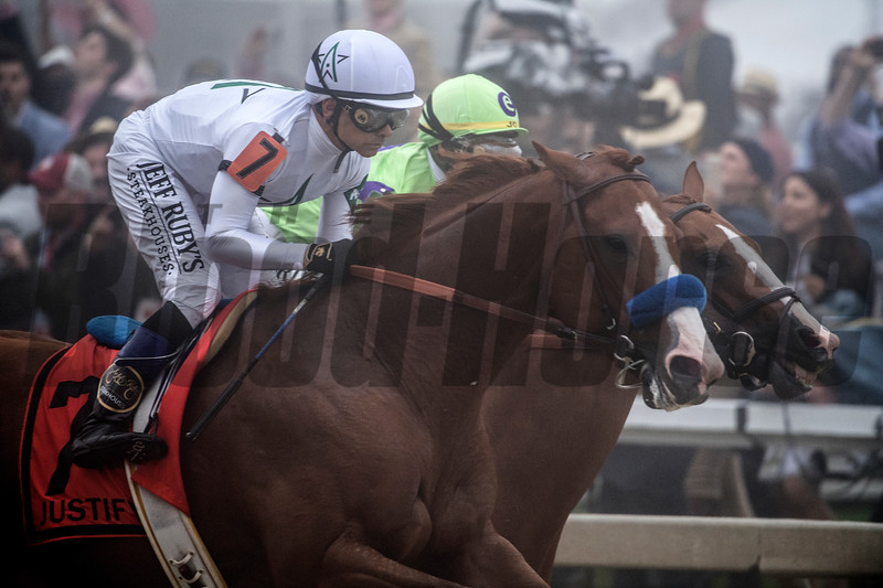 Jockey Mike Smith guides Justify past the clubhouse for the first time during the running of 143rd running of the Preakness Stakes May 19, 2018 in Baltimore, MD  Photo by Skip Dickstein