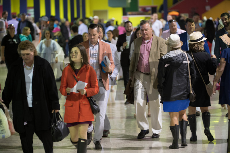 Crowds have gone inside due to the implement weather on Preakness Day at Pimlico Race Course Saturday May 19, 2018.  Photo by Skip Dickstein