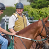 Trainer Bill Mott speaks with his exercise riders on the main track Thursday June 6, 2019 at Belmont Park in Elmont, N.Y.  Photo by Skip Dickstein