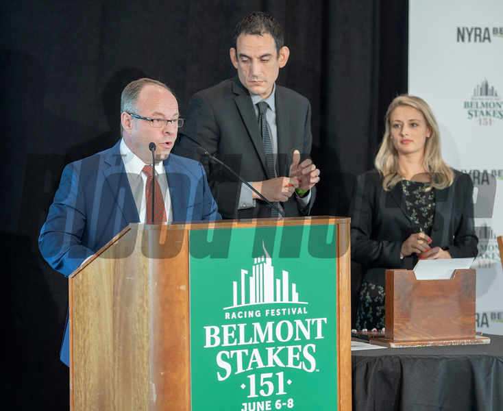 Track announcer Larry Colmus, left with members of the Racing office Keith Doleshel, center and Jorie Gorski pull the pills for the 151st Belmont Stakes Post Position Draw held at Citi Field Tuesday June 4, 2019 in Queens, N.Y.  Photo by Skip Dickstein