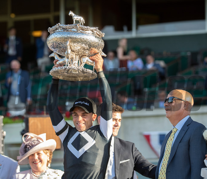 Jockey Joel Rosario holds the winner's trophy up after he road Sir Winston to the win in the 151st running of the Belmont Stakes held Saturday June 8, 2019 at Belmont Park in Elmont, N.Y.  Photo by Skip Dickstein