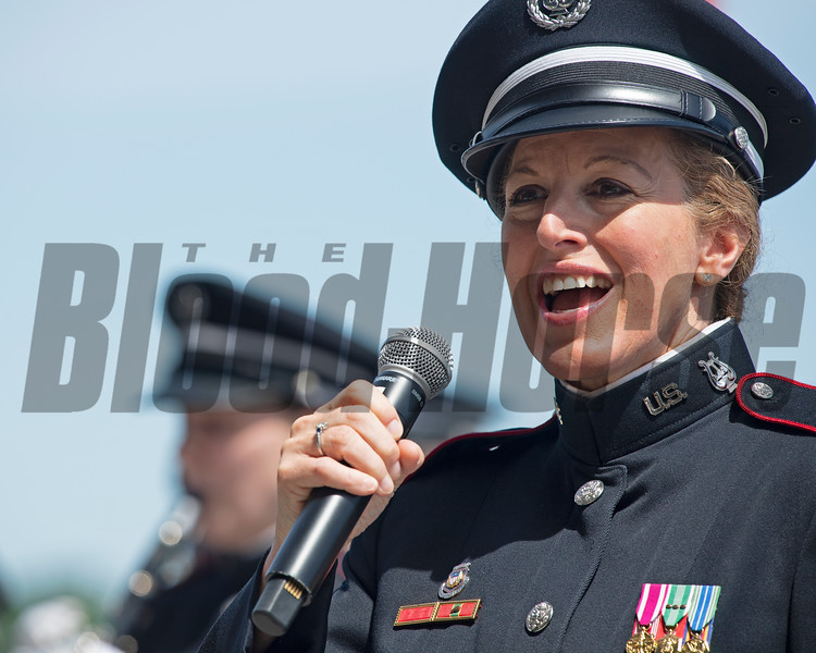 Vocalist MaryKay Messenger with West Point Band singing God Bless America<br /> on June 8, 2019 in Elmont,  NY.