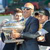 Jockey Joel Rosario give trainer Mark Casse a hand with  the winner's trophy up after Sir Winston won the 151st running of the Belmont Stakes held Saturday June 8, 2019 at Belmont Park in Elmont, N.Y.  Photo by Skip Dickstein