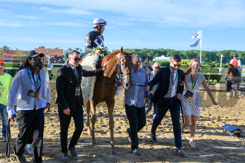 Sir Winston ridden by jockey Joel Rosario is lead to the winner's circle by their connections after winning the 151st running of the Belmont Stakes held Saturday June 8, 2019 at Belmont Park in Elmont, N.Y.  Photo by Skip Dickstein
