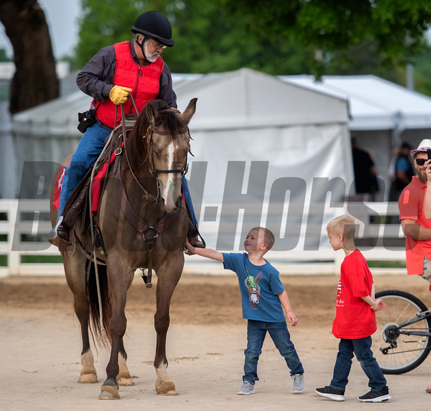 Outrider Kenny LaVergne entertains the kids on the backside of Churchill Downs Wednesday May 1, 2019 in Louisville, KY.<br /> Photo by Skip Dickstein