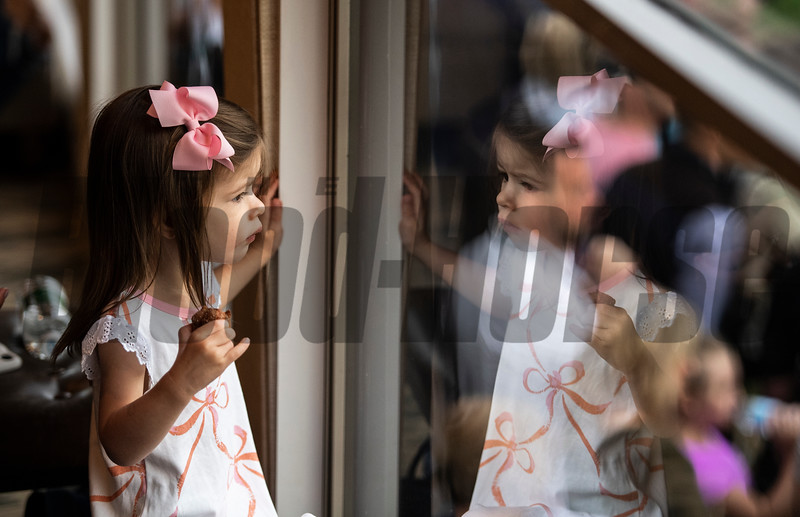 Land Deskins, 2 of Louisville looks at her mirror image in the Keeneland Tent at Churchill Downs Wednesday May 1, 2019 in Louisville, KY.<br /> Photo by Skip Dickstein