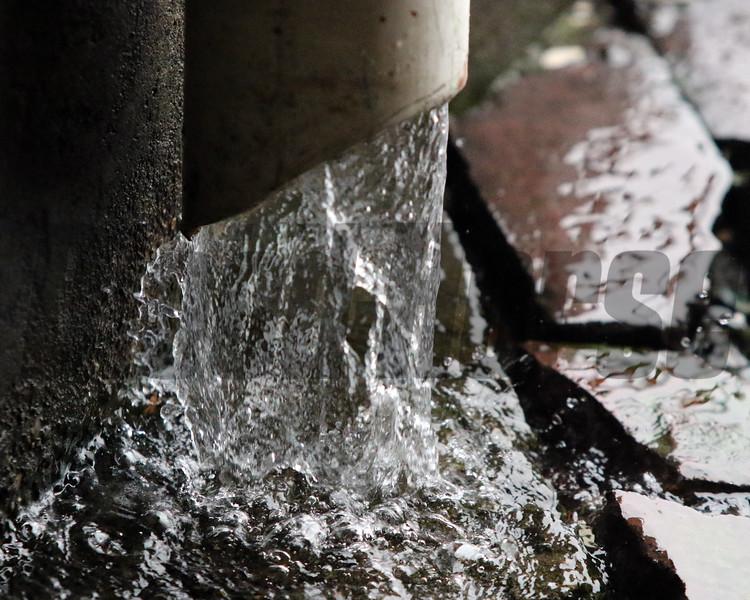 Rain spout at Churchill Downs on May 3, 2019. Photo By: Chad B. Harmon