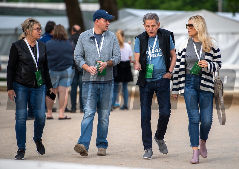 Randy Hill, part owner of Vekoma, second from right, heads for the Keeneland Tent at Churchill Downs Wednesday May 1, 2019 in Louisville, KY.<br /> Photo by Skip Dickstein