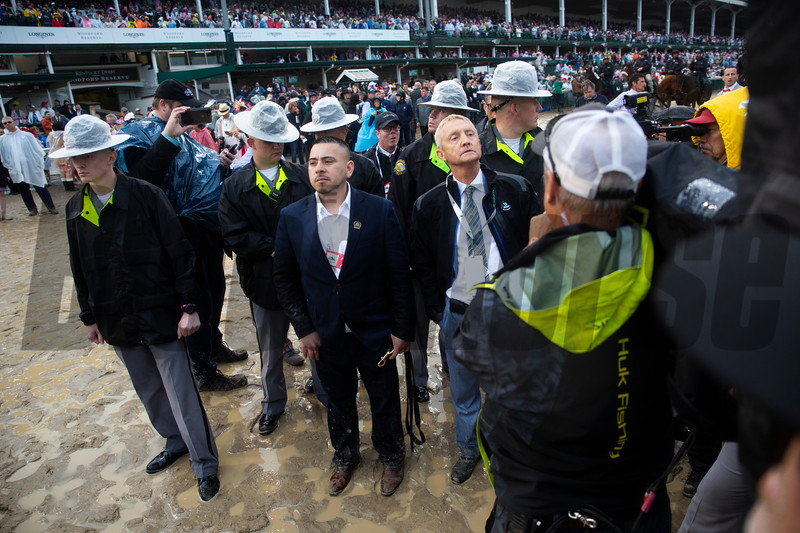 Jason Servis waits for the final call of the winner of the Kentucky Derby at Churchill Downs on Derby Day on May 4, 2019 in Louisville, Ky.