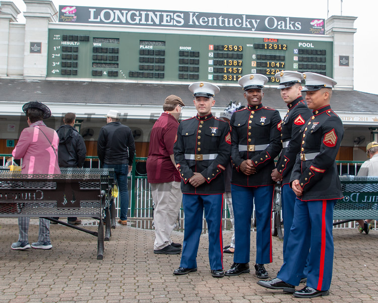Marines pose near the paddock on Oaks Day.