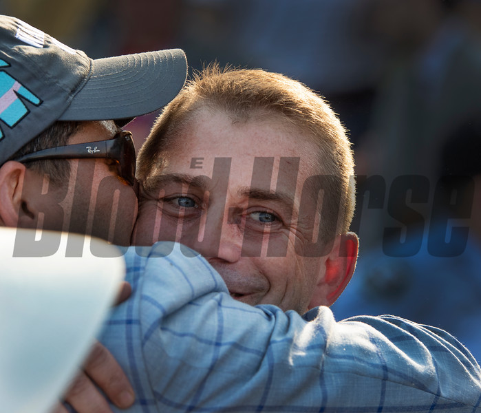 Trainer Jonathan Thomas gets a hug and kiss from owner Sol Kumin after Catholic Boy ridden by jockey Javier Castellano won the 118th running of The Maker's Mark Dixie Stakes (GII) at Pimlico Race Course Saturday May 18, 2019 in Baltimore, MD.  Photo by Skip Dickstein
