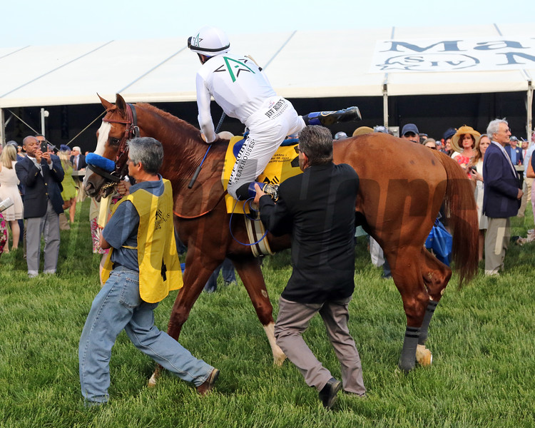 Mike Smith gets a leg up on Improbable prior to the 144th Running of the Preakness Stakes at Pimlico on May 18, 2019. Photo By: Chad B. Harmon