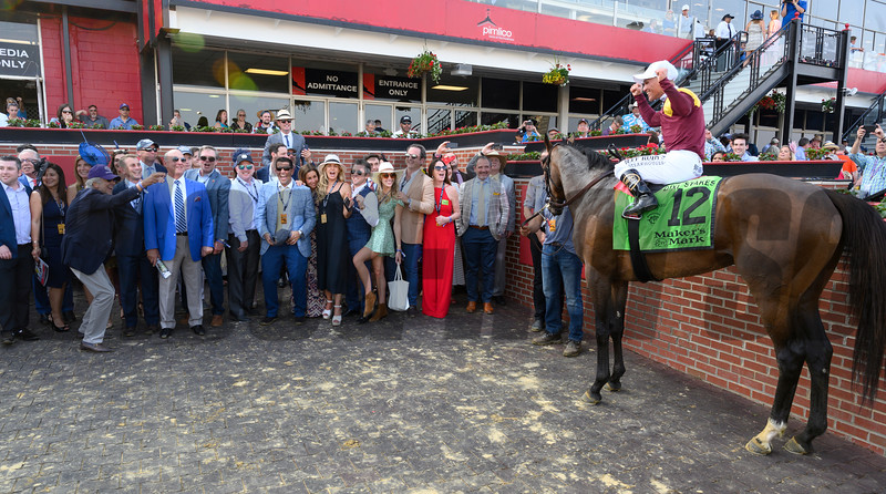 Connections gather in the Winner's Circle after after Catholic Boy ridden by jockey Javier Castellano won the 118th running of The Maker's Mark Dixie Stakes (GII) at Pimlico Race Course Saturday May 18, 2019 in Baltimore, MD.  Photo by Skip Dickstein