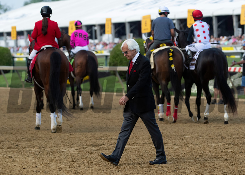Trainer Bob Baffert walks from the saddling area after putting jockey Mike Smith aboard race favorite Improbable in the 144th running of The Preakness Stakes Saturday May 8th at Pimlico Race Course in Baltimore, MD.  Photo by